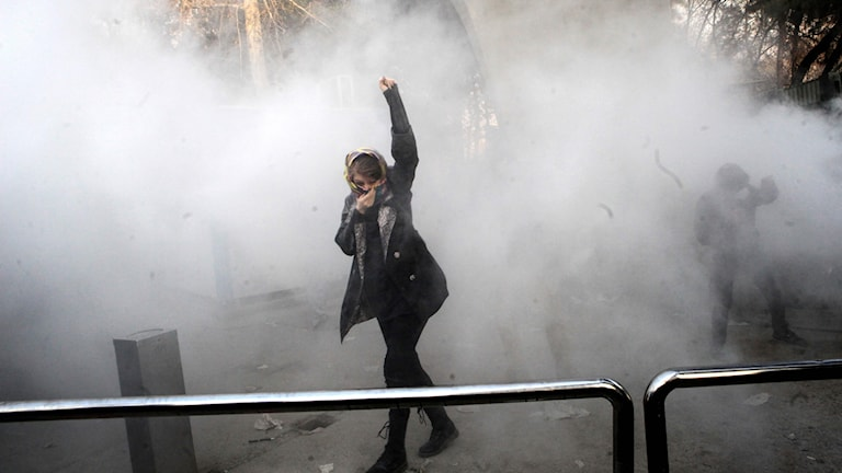 Woman protesting in Iran.