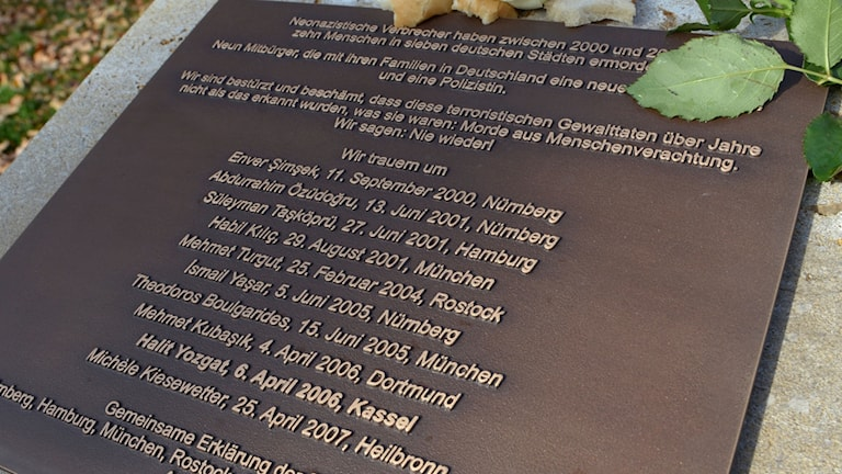 In this Nov. 5, 2012 file photo a rose sits on the memorial for the victims of the NSU terror group in Kassel, Germany