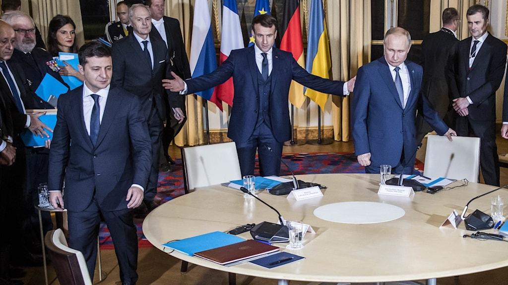 Russian President Vladimir Putin, right, French President Emmanuel Macron, center, and Ukrainian President Volodymyr Zelenskiy