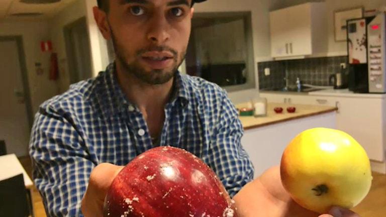 Shadi Mattar och två äpplen.