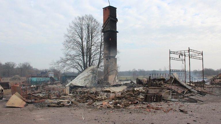 Nedbrunnet hus. Foto: Polisen.