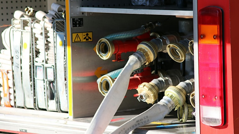 Vattenslangar i brandbil.