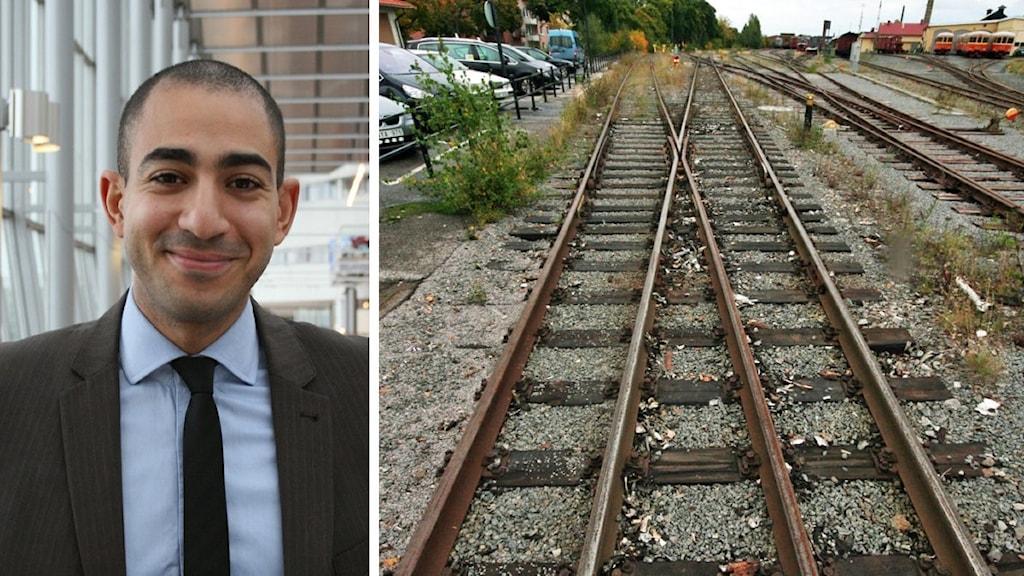 Man med kostym och slips bredvid bild på järnvägsspår.