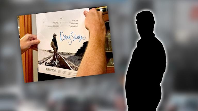 Infälld bild på man som håller i en LP-skiva och siluett.