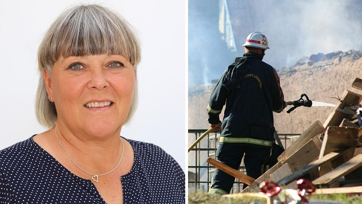 Kvinna i blå tröja och brandman som släcker eld.