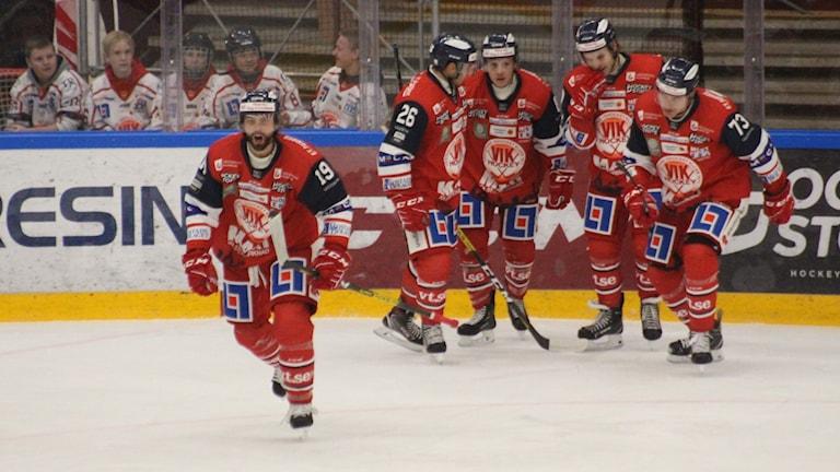 Glada ishockeyspelare.