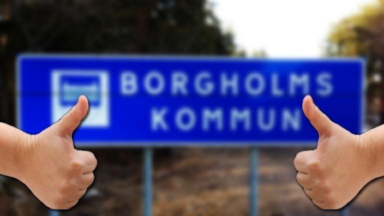 Borgholms kommun-skylt och två tummar upp.