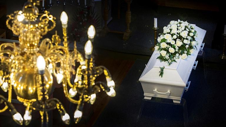 En vit kista med blommor
