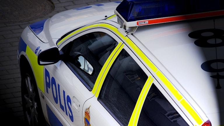 En polisbil sedd ovanifrån. Foto: Hasse Holmberg/Scanpix.
