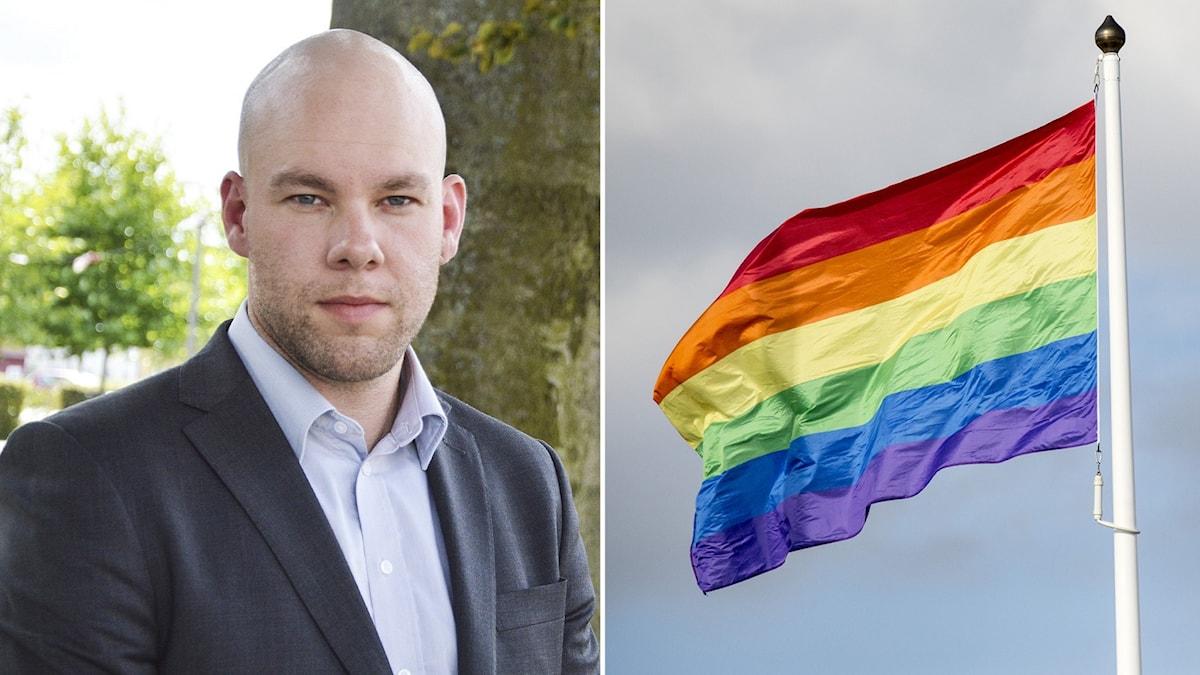 Johan Rocklind (S), kommunstyrelseordförande i Gnesta, inklippt vid sidan av vajande Pride-flagga.
