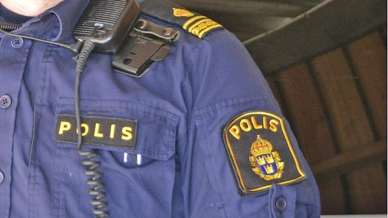 Polisuniform. Arkivbild: Sveriges Radio