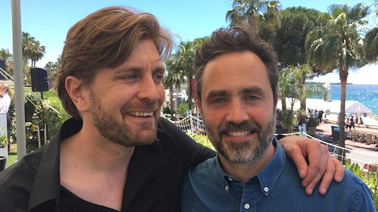 """Ruben Östlund och """"The Square""""-producenten Erik Hemmendorff."""