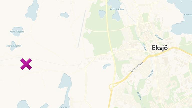 En karta med en kryss på.