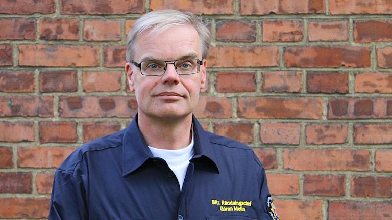 Göran Melin i blå uniform.