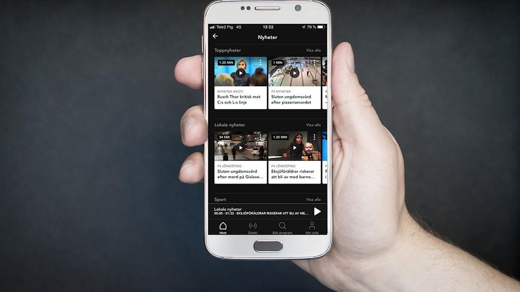 Lokala nyheter visas på en mobilskärm.