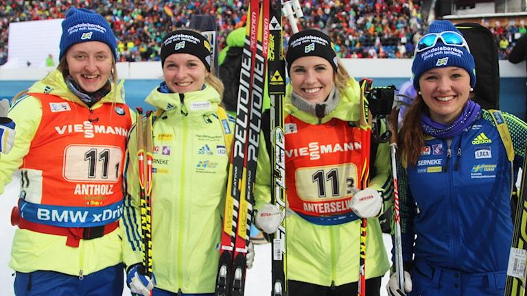 Emma Nilsson , Mona Brorsson, Ingela Andersson och Linn Persson efter en stafett i Anholtz i vintras. Foto: Skidskytte.se