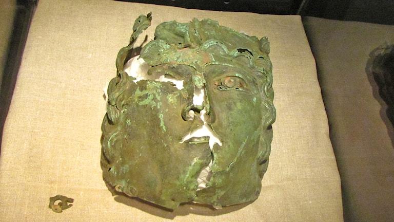 Romersk bronsmask. Foto: Ulrika Uusitalo Fernholm/Sveriges Radio