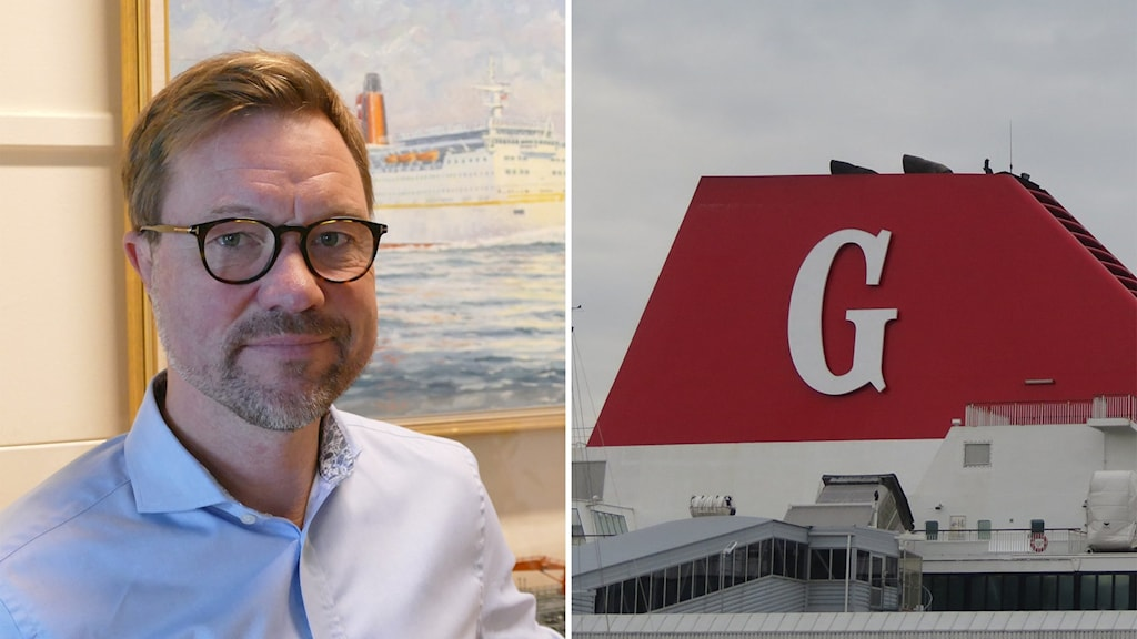 En man i skjorta och glasögon och ett stort G på ett fartyg.