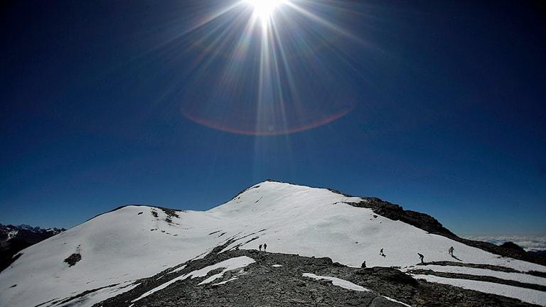 Solen skiner över Andernas bergstoppar. Foto: Juan Karita/TT