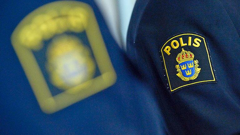 Emblem på polisens uniform Foto: Janerik Henriksson/TT