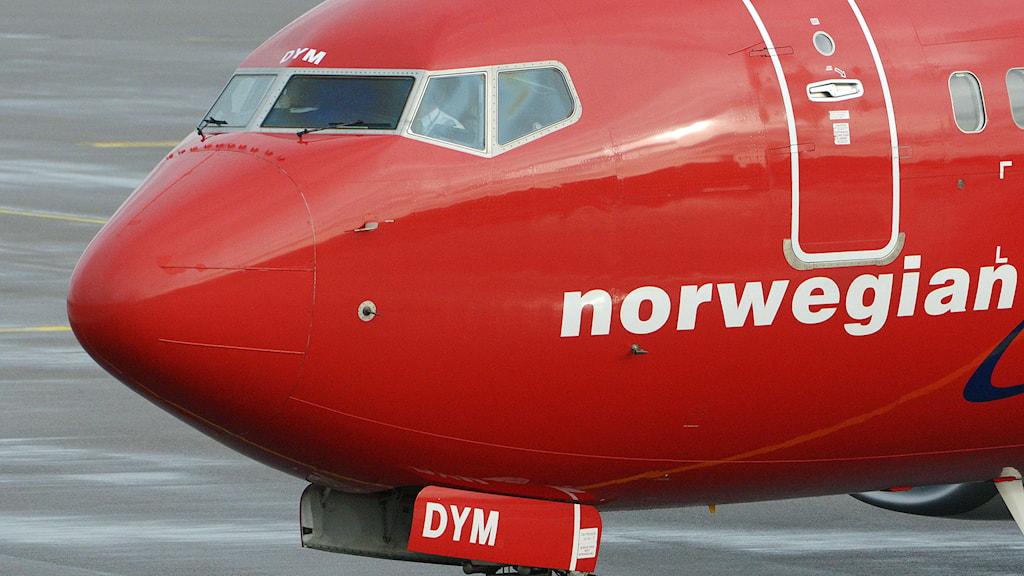 Ett Norwegianplan står på marken. Foto: Johan Nilsson/TT