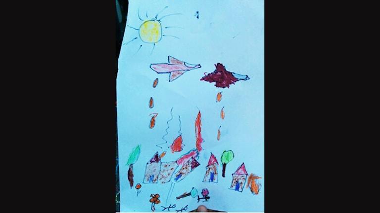 Teckning ritad av barn på flykt, ritad på Malmö C. Foto: Sveriges Radio