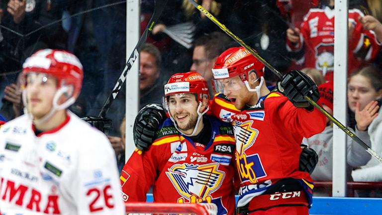 Två hockeyspelare.