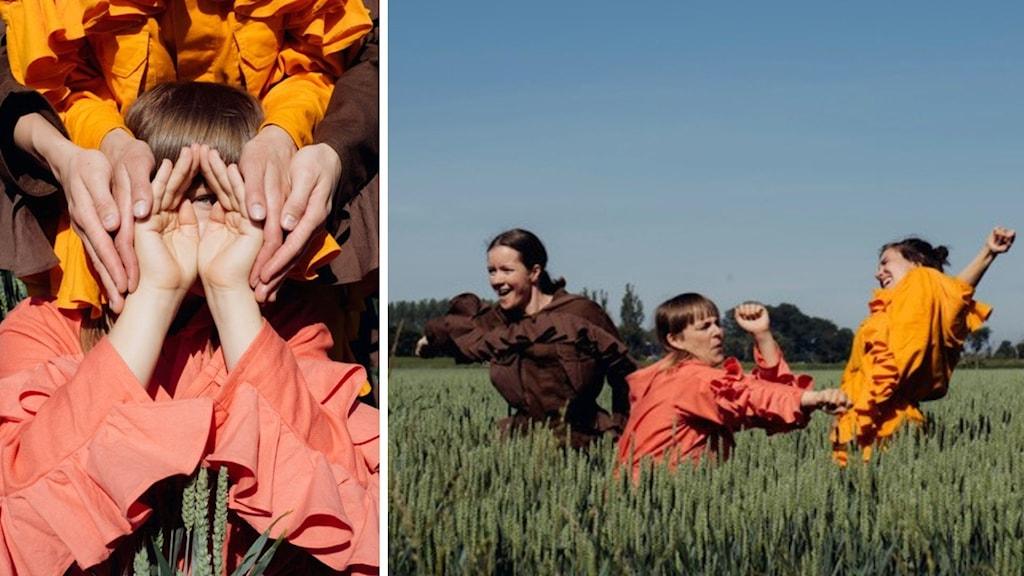 Tre personer i färgglada kläder som dansar i gräset.