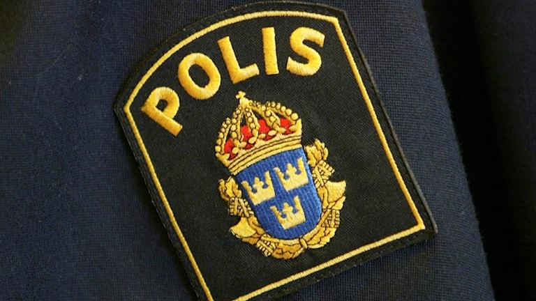 Polismärke.