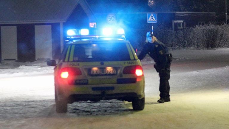 Polisbil med blåljus. Foto: Sveriges Radio