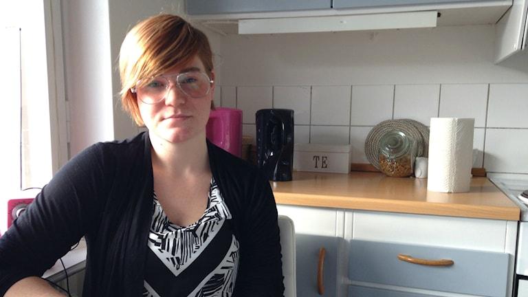Lina Färdigh bor i bostadshuset som riskerar att rivas.