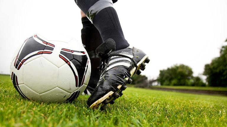 Foten på en fotbollsspelare.